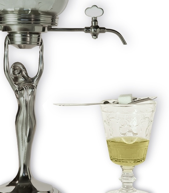 Detail of Versailles absinthe glass with absinthe, spoon, sugar and small absinthe fountain.