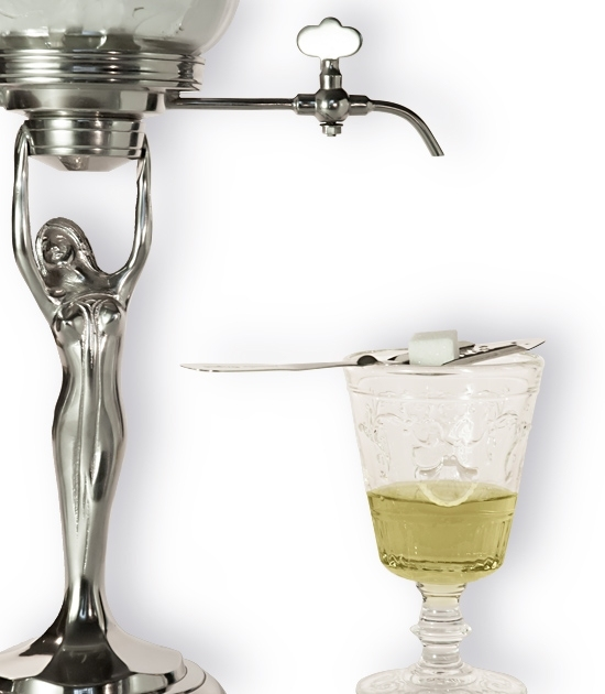 Detail of small metal Lady Absinthe Fountain with glass of Absinthe and a spoon with sugar.