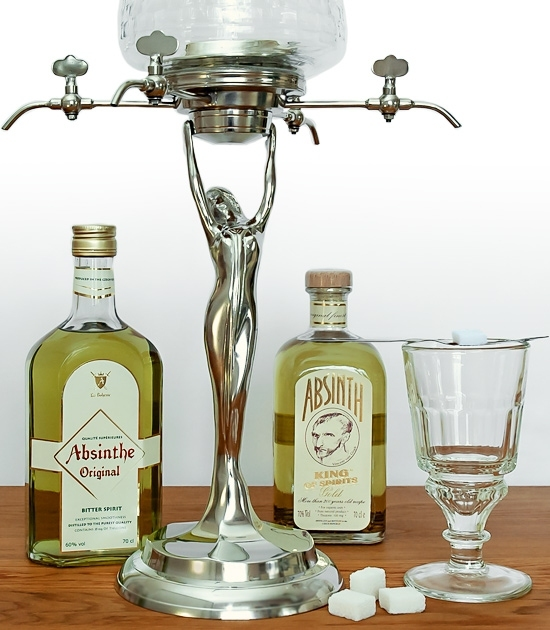 Lady absinthe fountain with two bottles of premium absinthe, glass, absinthe spoon and sugar cubes.