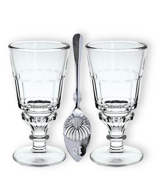 two traditional absinthe Pontarlier glasses with two slotted absinthe spoons